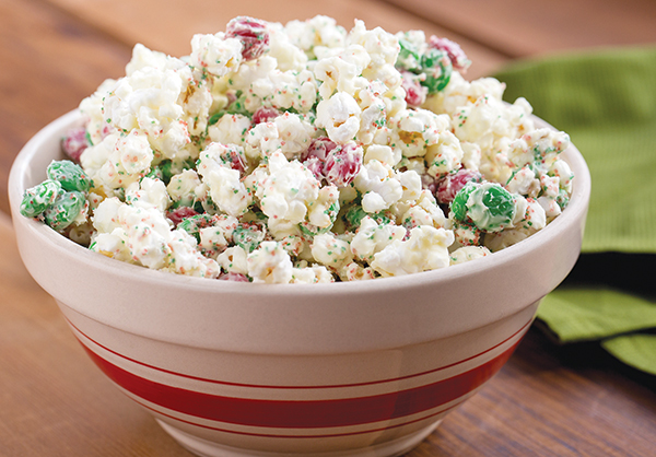A simple bag of popcorn with sprinkles, candy cane, chocolate, and peppermint makes a decadent holiday treat.